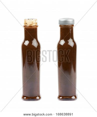 Glass bottle of barbecue bbq sauce isolated over the white background, set of two different foreshortenings