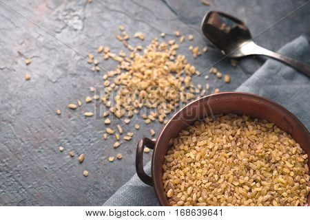 Placer bulgur on a table and in a bowl diagonal horizontal