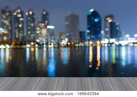 Opening wooden floor blurred bokeh lights office building night view abstract background