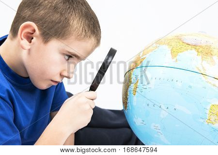 Africa magnified with boy magnifier
