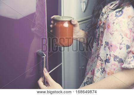 Women hands are open the cupboard doors