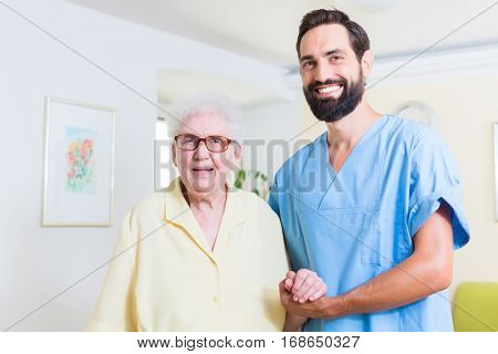 Geriatric nurse and senior in old age home