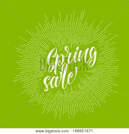 Modern hipster spring sale lettering with sunrays on fresh green background