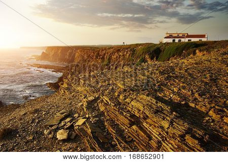 House in the cliff on the Atlantic Ocean coast in the Alentejo region in Portugal