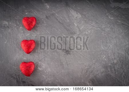 red and pink hearts on grey background