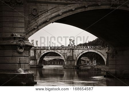 River Tiber with Ponte Vittorio Emanuele II and Ponte Sant Angelo in Rome, Italy.