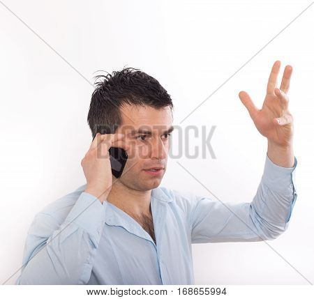 Stressed Man Talking On Cell Phone