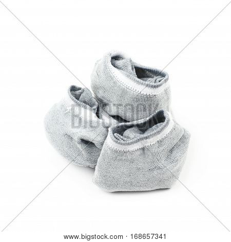 Pile of a gray low-cut ped socks isolated over the white background