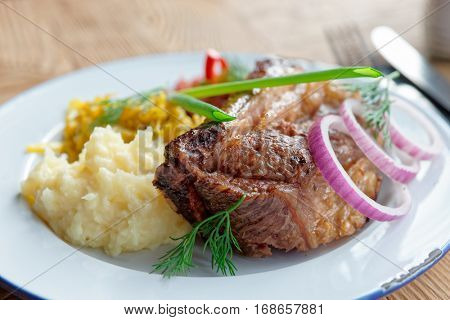 Grilled pork ribs with sauerkraut and mashed potatoes - hearty dish