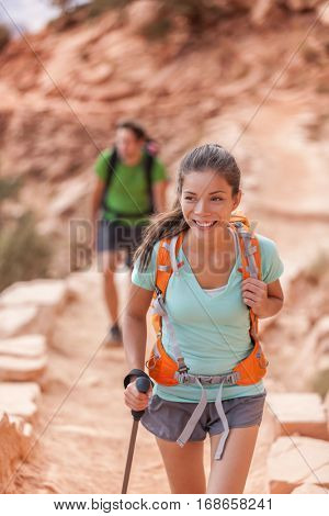 Grand Canyon hiking people. Hiker couple enjoying hike on South Kaibab Trail, south rim of Grand Canyon, Arizona, USA. Young multiracial hikers.