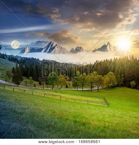 time concept of day and night change in composite summer mountain landscape. rural valley with fence on a grassy meadow. curve road goes to the spruce forest in front of a huge ridge with rocky peaks