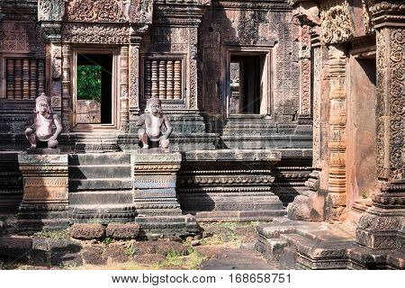 monkey gardians carvings at Banteay Srei red sandstone temple