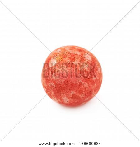 Single red colored foam ball or a corn cereal candy isolated over the white background