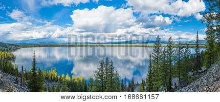 Beautiful crystal clear water of the Jenny Lake. Wyoming, Grand Teton National Park, USA. Panorama