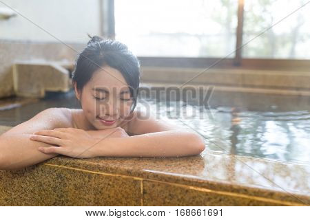 Young woman relaxing in Japanese onsen