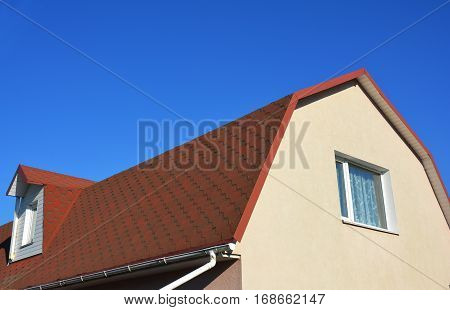 Exterior House Attic Dormer Window and Roofing Construction. Gable roof and dormer type of roof.