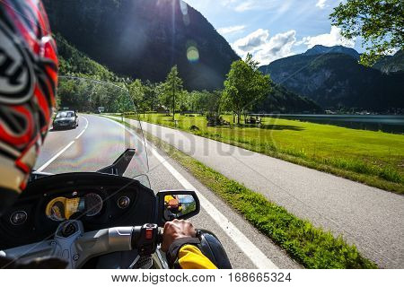 Chronicles of bikers or road adventure. Sunny road.