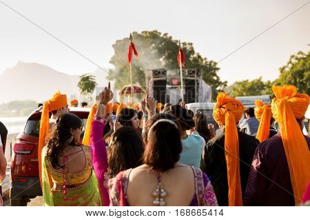 UDAIPUR, INDIA - CIRCA NOV 2016: People celebrating a street wedding in Udaipur, India.