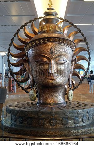 DELHI, INDIA - FEBRUARY 19: Surya, the resplendent one by Satish Gupta, the big golden statue in Airport of Delhi on February 19, 2016. Indira Gandhi Airport is the 32th busiest in the world.
