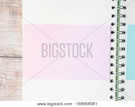 Open notebook blank empty page to fill with text. Pastel color invitation card. Top view
