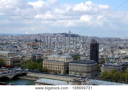 Aerial view of Paris with Sacre-Coeur dominating the horizon France.