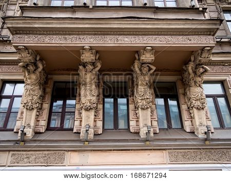 Saint-Petersburg, February 13 2016: Support in the form of female figures on the balcony of the house 79 on the Nevsky Prospect