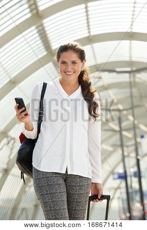 Young Smiling Travel Woman Using Cell Phone