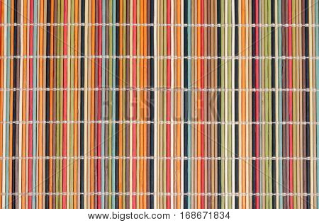 Colourful bamboo straw mat as abstract texture background