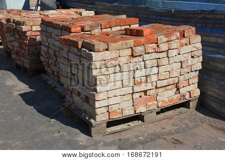 Old Brick building material on the construction site outdoor.