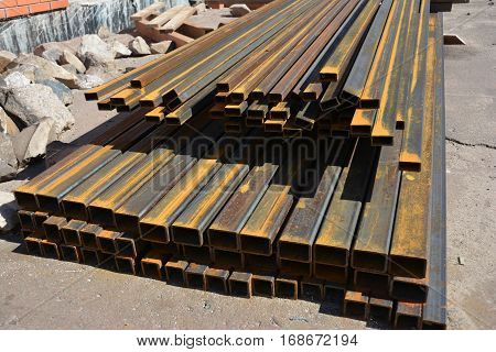 Steel beams for roofing.Rust steel channel bunch on house construction site outdoor.