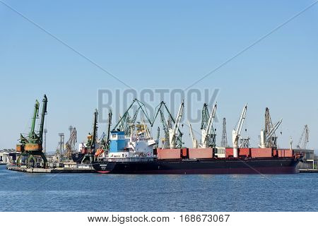 VARNA, BULGARIA - MARCH 30, 2014: Port of Varna the largest seaport complex in Bulgaria. Located on the Black Sea's west coast on Varna Bay along Lake Varna and Lake Beloslav