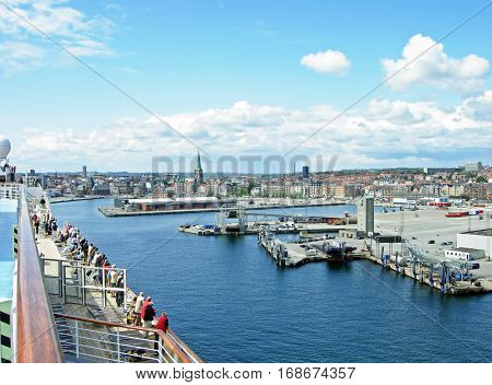Aarhus, Denmark - June 6, 2009: View over the port and the city of Aarhus, Denmark. The port of Aarhus has the largest container terminal in Denmark.