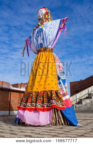 Scarecrow doll dressed in Shrovetide clothes Russian