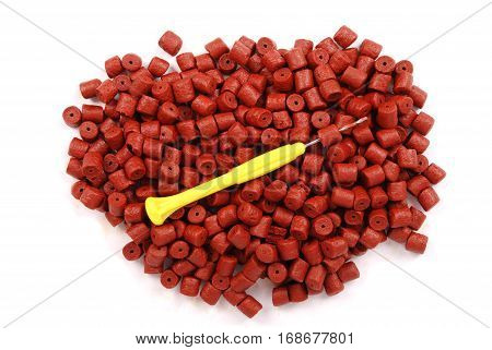 Red pre-drilled halibut pellets for carp fishing Isolated on white background with soft shadow