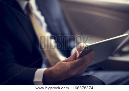 Businessman Using Tablet Working Car Inside