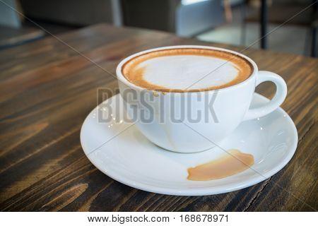 hot coffee mocha with foam milk in vintage cafe