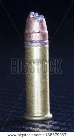 Rimfire cartridge with a bullet that has been cut