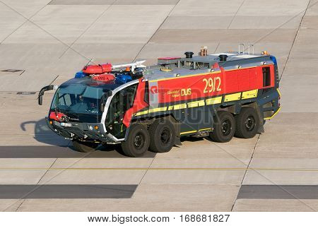 DUSSELDORF GERMANY - DEC 16 2016: Rosenbauer Panther Crashtender driving on the tarmac of Dusseldorf Airport.