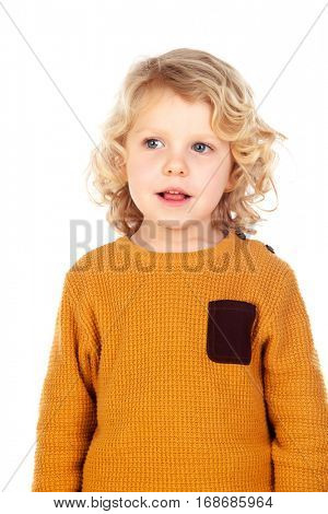 Shy small child with yellow jersey isolated on a white background