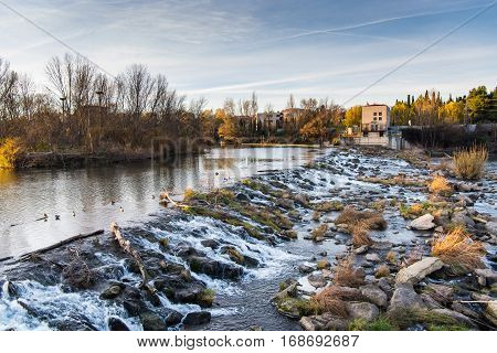 A waterfall on the Ebro river in Logrono, La Rioja region from Spain