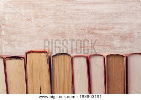 Vintage old books over wooden background. Education concept