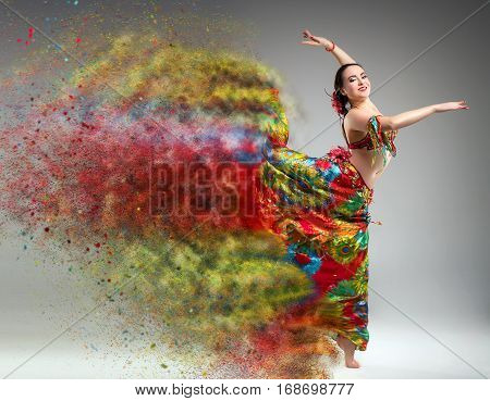 Dancer with disintegrating dress. Abstract vision.Photo manipulation