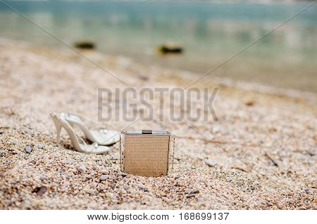 stylish ladies handbag on beach. Fashion bag