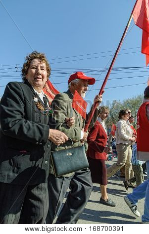 Tyumen, Russia - May 9. 2009: Parade of Victory Day in Tyumen. Members of Commubist Party of Russian Federation on parade