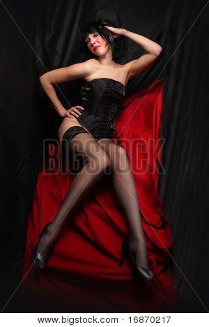 Low key lighting studio shot young beautiful women on red background