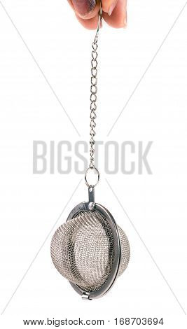tea strainer on a chain in a hand isolated on white background.
