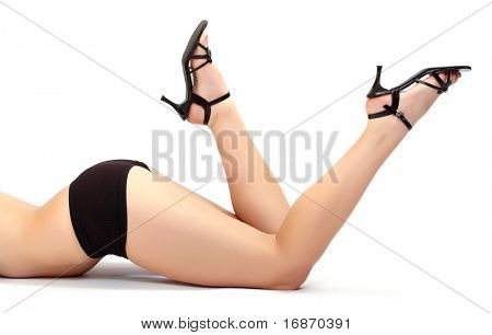 Great shoot of slim sexy legs on white background.