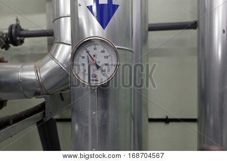 ST. PETERSBURG, RUSSIA - DECEMBER 16, 2016: Thermometer at the outgoing water in one of the central heating points. There is 219 central heating points in the city, 60 of which is automated