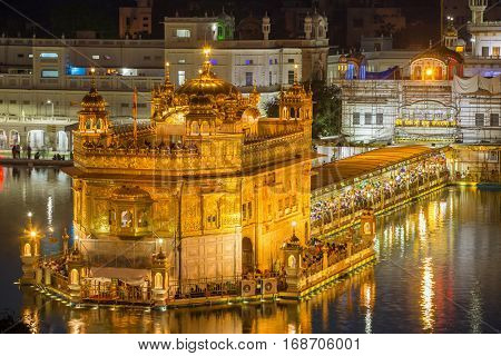 Amritsar, India - March 30, 2016: Golden Temple (Harmandir Sahib) at night in Amritsar, Punjab, India