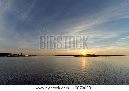 A View Of The Calm Golden Sunset On The River With The Sun Reflected In It, Volga, Russia